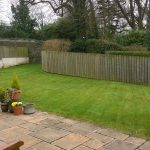 fencing around a garden with concrete walkway